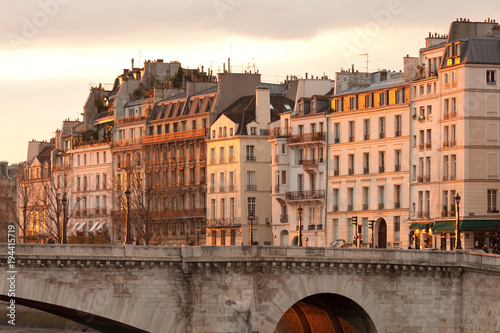 Facades of apartment buildings at Ile Saint Louis and Pont de la Tournelle bridge, Paris, France