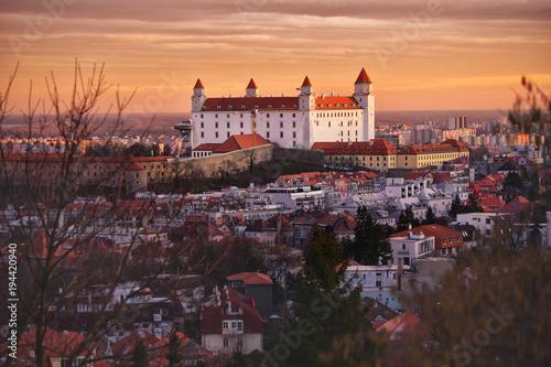 Keuken foto achterwand San Francisco Bratislava castle in orange sunset light. Old historical town Slovakia