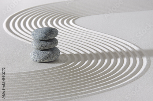 Japanese ZEN garden with stacked rocks in white textured sand - 194422172