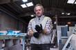 Man setting machine in workshop