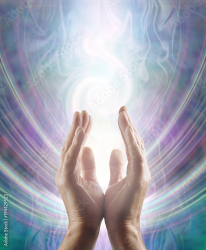 Photo  Sensing Spiralling Healing Energy - male  hands reaching up and sensing an ether