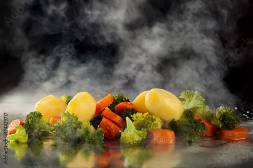 Steamed vegetables on tray. Wallpaper Mural