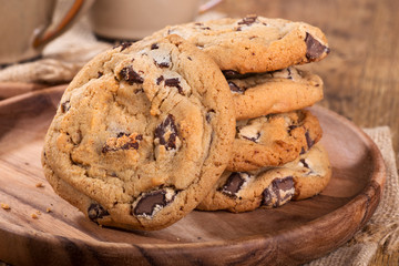 Closeup of chocolate chip cookies on a wooden plate
