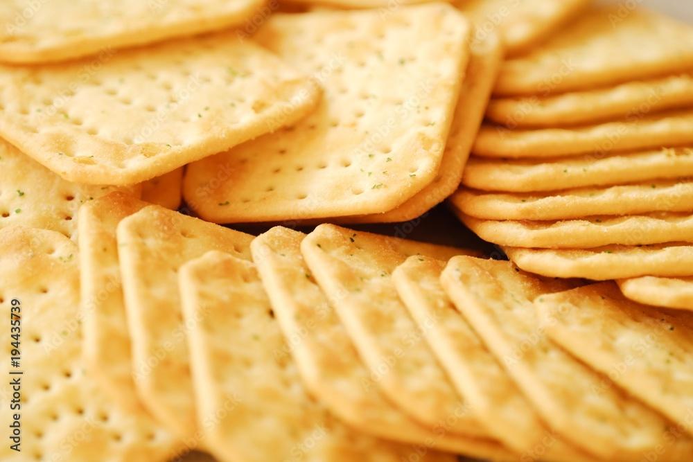 Fototapeta Fresh crunchy cracker with onion and salt