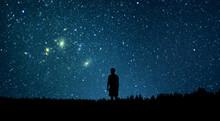 Man Looking At The Stars. Alon...