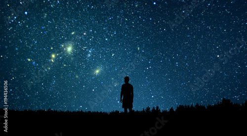 Foto op Plexiglas Nachtblauw Man looking at the stars. Alone man looking at starry sky. Night sky.