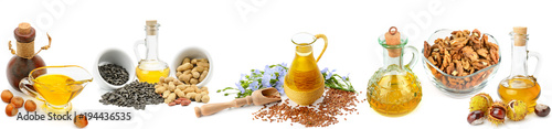 Set of vegetable oils, nuts and seeds isolated on white background. Panoramic collage. Wide photo.