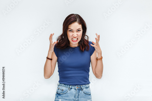 Fotografía A very frustrated and angry hatred woman isolated on white background in studio