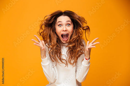 Fotografie, Obraz  Screaming young woman standing isolated