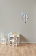 decorative baby child room interior. cozy decor and white table and chair style.