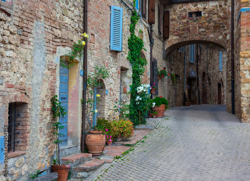 Fototapety, obrazy: street of a small old town in Tuscany. Italy