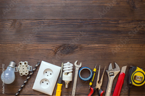 Different electric instruments on a wooden background. Free space for text