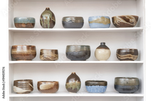 Canvas Print Ceramic container / View of ceramic container on wooden shelf.