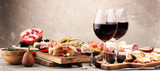 Italian antipasti wine snacks set. Cheese variety, Mediterranean olives, pickles, Prosciutto di Parma and salami - 194461961