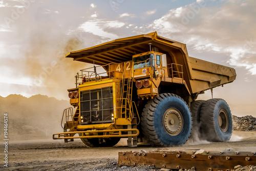 Mining dump trucks transporting Platinum ore for processing Fototapeta