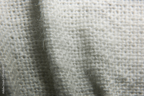 Valokuva Texture of knitted fabric in a mesh with folds