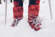 Close-up Winter Boots On Snow