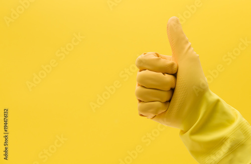 Thumbs up hand gesture made by a hand in a yellow rubber cleaning glove Canvas Print