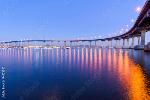 Plagát  Coronado Bridge at Dusk - A close-up dusk view of Coronado Bridge, winding over calm San Diego Bay, at San Diego, California, USA