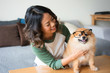 Smiling Woman with Spitz Wearing Glasses at Home