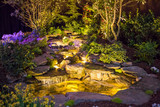 Brightly Lit Waterfall and Pond