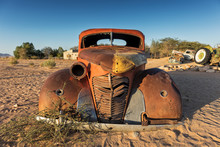 Old And Abandoned Car In The D...