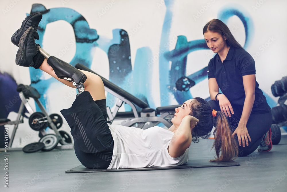 Fototapety, obrazy: Disabled woman exercising with personal trainer