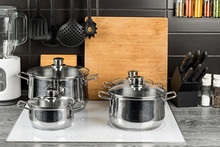 Stainless Steel Cooking Pots In Kitchen On White Induction Hob Food Cooking Background