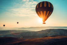Hot Air Balloons Flying Over The Valley At Cappadocia.
