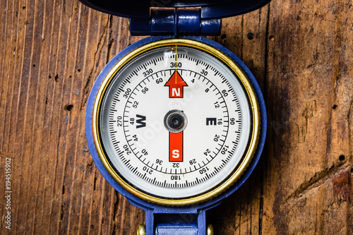 Plakat Compass on Wooden Background