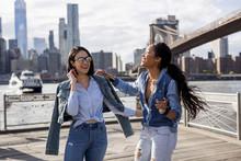 Two Friends Having Fun In Brooklyn, New York.