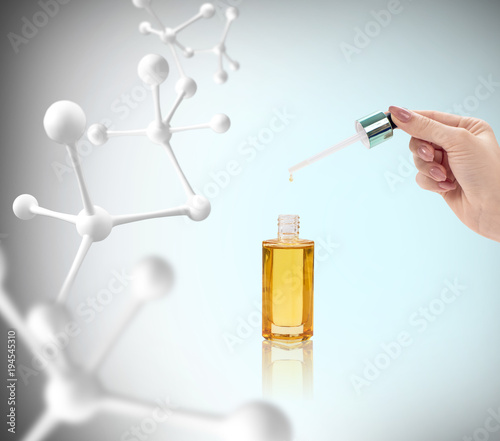 Anti-aging cosmetics oil for skin among molecules.