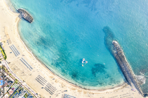 Staande foto Canarische Eilanden Aerial view of Los Cristianos bay beach in Tenerife with sunbeds and umbrellas miniature - Travel concept with nature wonder landscape in Canary islands Spain - Bright warm day filter