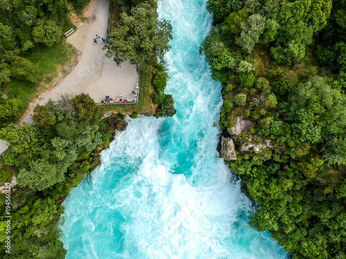 Montage in der Fensternische Wasserfalle Stunning aerial wide angle drone view of Huka Falls waterfall in Wairakei near Lake Taupo in New Zealand. The waterfall is part of the Waikato River and is a major tourist attraction.