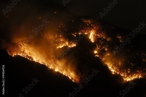 Fotografie, Tablou  Night photography of a hell of fire in a mountain forest