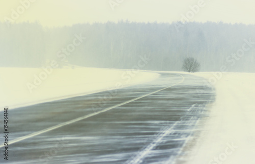 Fotobehang Poolcirkel Winter. Blizzard snowstorm winter road of a snowy landscape. On the road there are no car