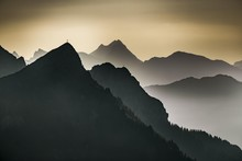 Morning Light With Mountain Ranges As Staggering And Mountaineering On Peaks, Tannheimer Tal, Tyrol, Austria, Europe