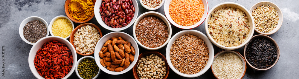Fototapety, obrazy: Superfoods and cereals selection in bowls: quinoa, chia, goji berry, mung bean, buckwheat, bean, turmeric, polba, bulgur, lentil, sesame, flax seed, wild rice, almond on grey concrete background
