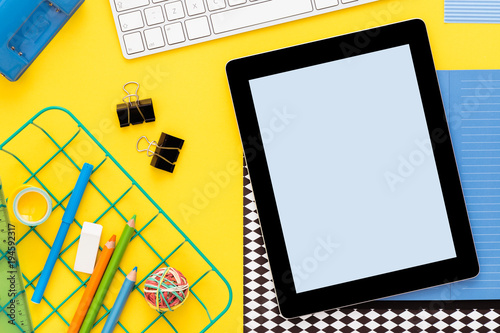 Fotografie, Obraz  Yellow background with digital tablet and school supplies