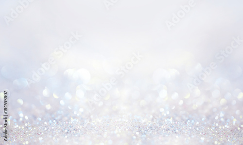 Glitter background in pastel delicate silver and white tones de-focused Fototapeta
