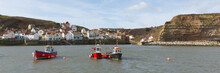 Staithes Yorkshire England Uk Seaside Town And Tourist Destination Panoramic View Of Boats In Harbour