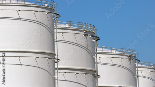 Photo Row of oil storage tanks