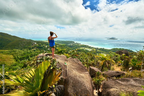 Fotografering Adventure woman hiking on chenard mountain, praslin, seychelles
