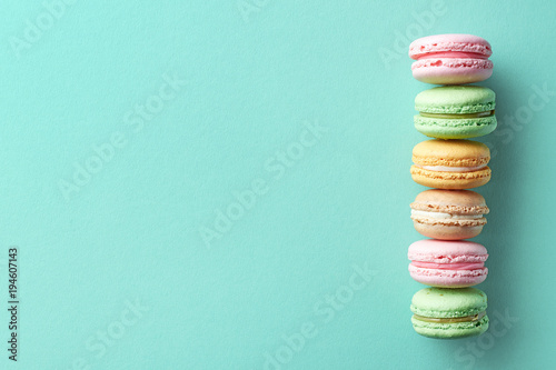 Foto op Plexiglas Macarons Colorful french macarons on blue background