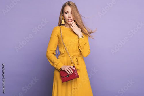 Fashionable woman in nice yellow dress, handbag and accessories. Fashion spring summer photo
