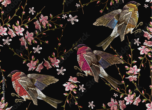 Fototapeta Embroidery birds and blossoming cherry seamless pattern