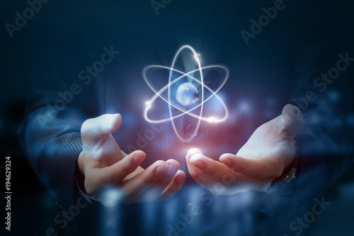 Photo Hands shows the atom .
