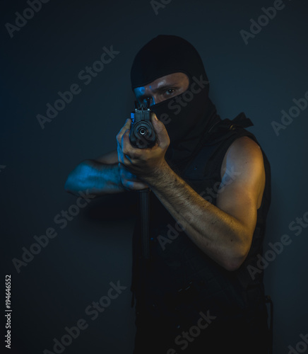 Mafia hit man, armed and dangerous man with balaclava and