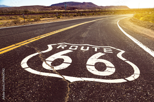 Spoed Fotobehang Route 66 Iconic Route 66 sign in American desert land