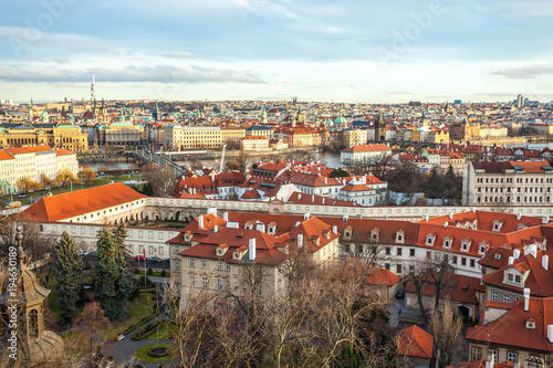 Photo  View of Prague over houses with red roofs